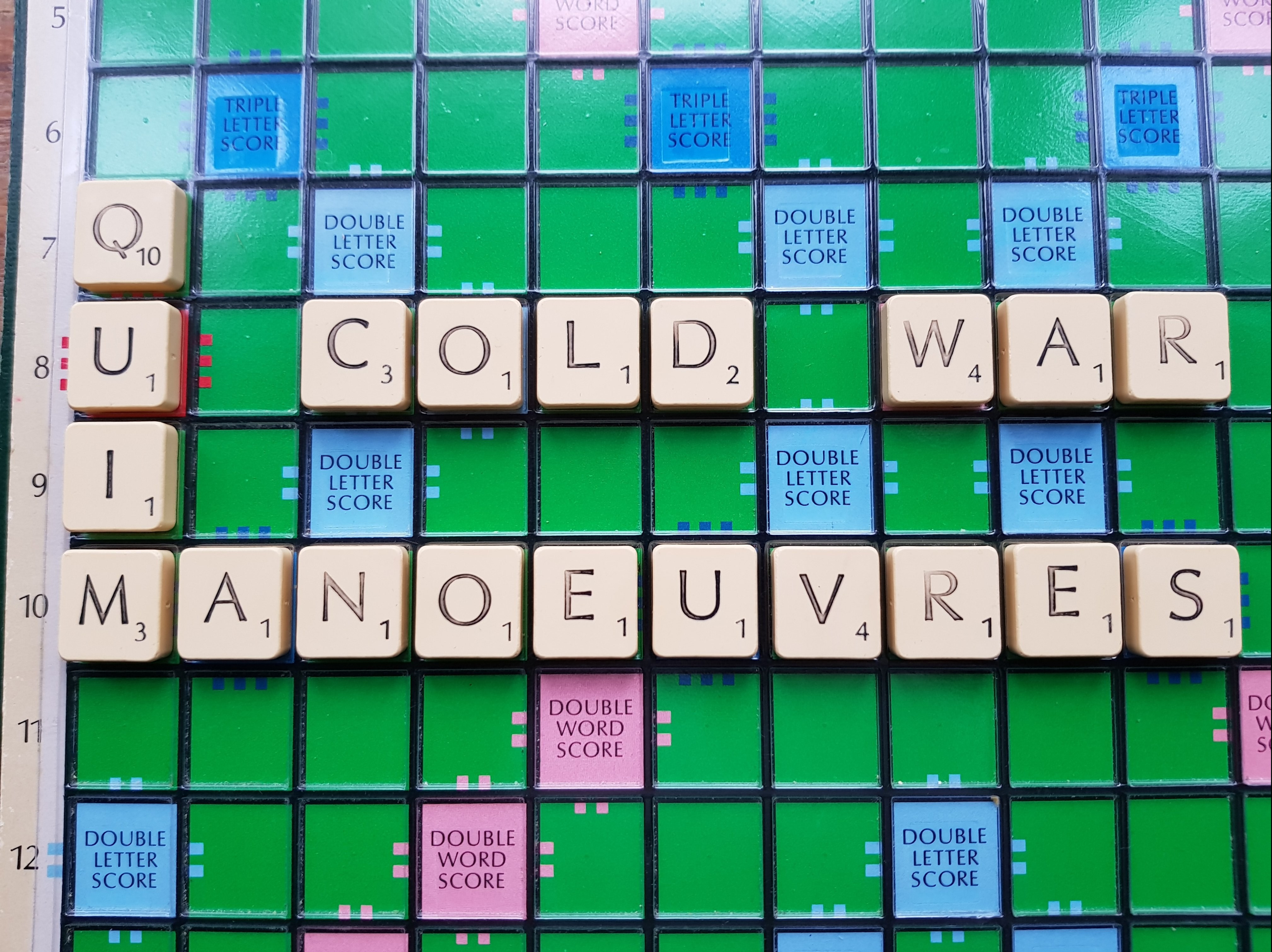 "Scrabble board reading ""quim"" and ""cold war manoeuvres"""